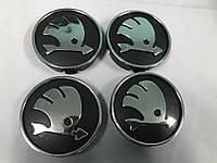 Skoda Octavia A5 2006-2010 гг. Колпачки в титановые диски 55 мм черные (4 шт)