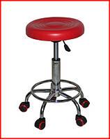 Красный парикмахерский стул без спинки
