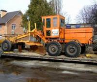 Перевозка строительно-дорожной техники тралом MAN 40 т