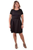 Черное маленькое платье колокол из плотного трикотажа.