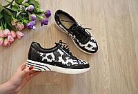 Женские черные кроссовки с пайетками