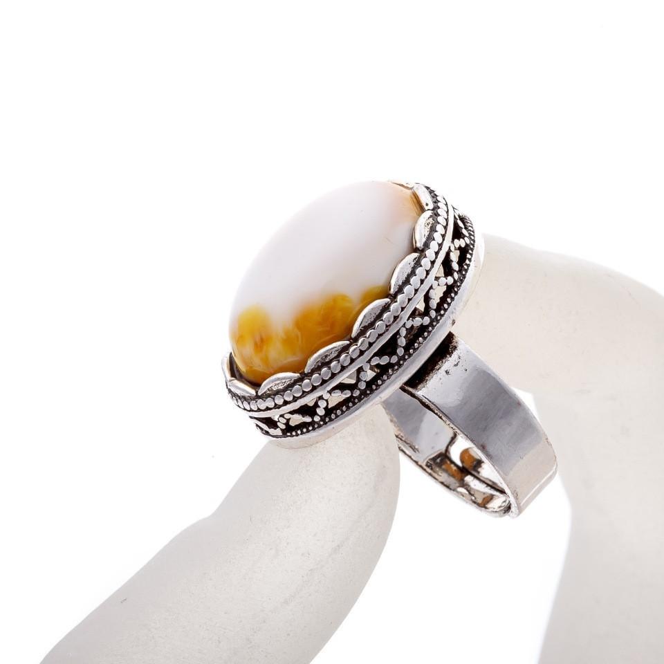 """Кольцо Янтарь  оправа  """"зубчик"""" """"М"""" овальный  камень 2,1*1,6 см без р-р"""