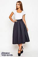Чёрная удлинённая женская юбка с карманами Дори.