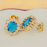 Позолоченные серьги гвоздики с маленькими сердечками голубой фианит в миниатюрных стразах
