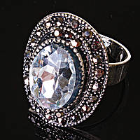 """Кольцо  оправа  """"под капельное серебро"""" белый овальный кристалл  2,5*1,8 см без р-р"""