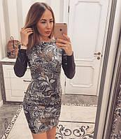 Красивое платье с перфорацией на рукавах