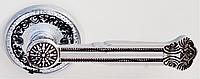 Дверная ручка на раздельной розе Genova 816 CP/BL хром/черный лак RDA
