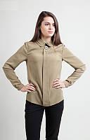 Стильная блузка свободного кроя с длинным рукавом и украшением