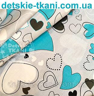 Ткань бязь с изогнутыми голубыми сердцами на сером фоне № 571