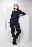 Стильный джинсовый комбинезон с накладными карманами