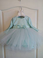 Нежное платье на девочку с пышной фатиновой юбкой декорировано стразами
