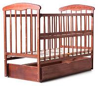 Кроватка детская Наталка, откидная боковинка с маятником и ящиком ясень темная