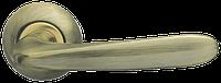 Ручка на раздельной розе Pava LD42-1AB/SG-6 бронза/матовое золото Armadillo (Китай)