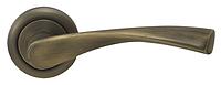 Дверная ручка на раздельной розе Vela CM 170 R59 матовая античная латунь Comit