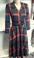 женское платье с пышной юбкой и поясом