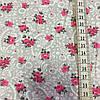 Ткань с мелкими малиновыми розочками на сером фоне с белым вензелем