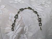 Женский браслет из стали, цепь, черепа со стразами