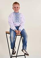 Нарядная сорочка вышиванка на мальчика для школы с синим орнаментом