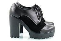 Черные туфли на высокой тракторной подошве с каблуком