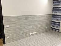 Инсталляция ламината на пол с плавным переходом на стену.