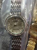 Часы наручные женские Rolex украшены камнями.