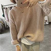 Женский свитер крупной вязки