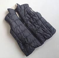 Тёплая детская жилетка Alive серого цвета 134-140 см.