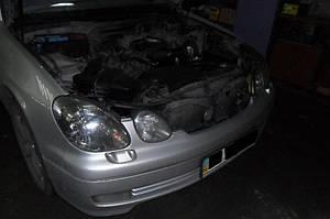Установка биксеноновых линз G5 с ребристыми масками с глазами на Lexus GS300 1