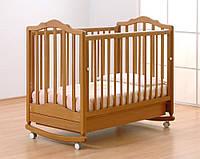 Гандылян Екатерина детская кроватка на колесах с ящиком