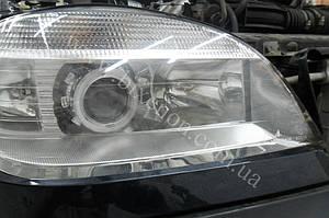 Установка биксеноновых линз G5 с глазами на Chevrolet Niva 4