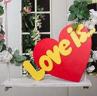 Табличка Love is...