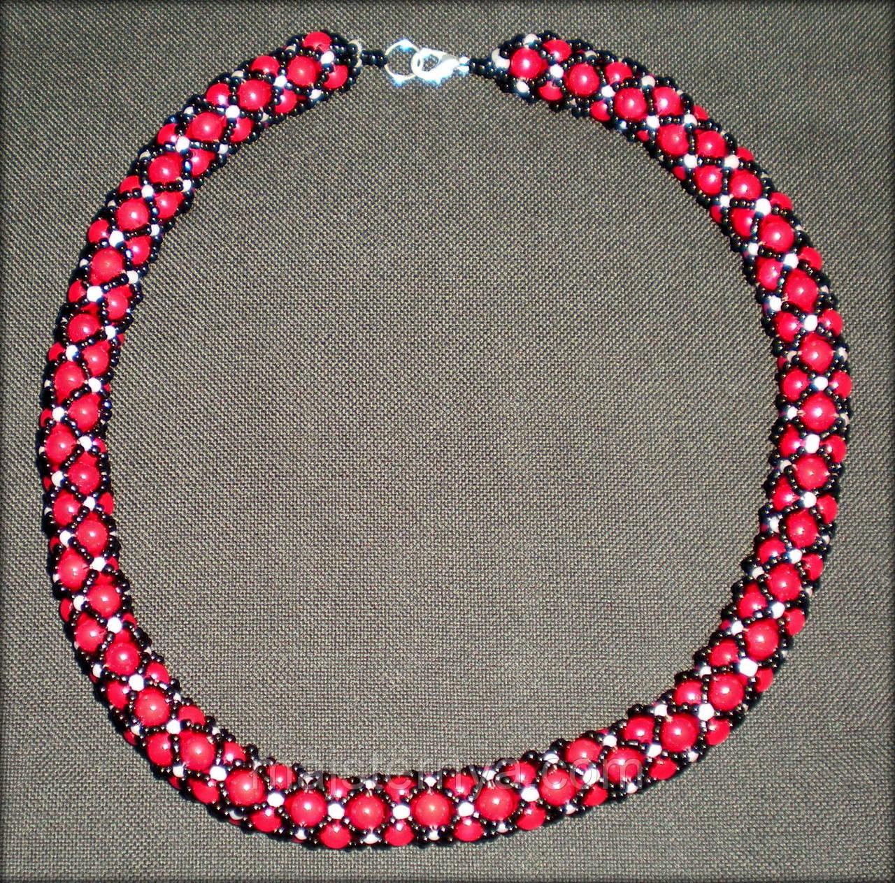 Джгут з чорного та білого бісеру і бусин червоного кольору