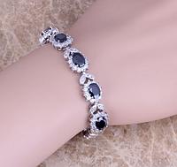 Женский серебряный браслет с сапфиром и топазом, фото 1