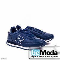 Модные женские кроссовки blue из качественной экокожи с декоративной нашивкой в виде буквы N на боку синие