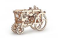 Трактор. Забавная модель механического конструктора с полным приводом и коробкой передач. 97 частей.