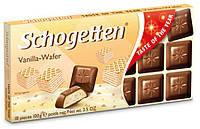 Молочный шоколад Schogetten с ванильным кремом и кусочками вафли, 100г
