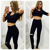 Женские джинсы завышенной посадки с дырками на коленях