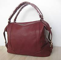 Удобная  женская сумка с короткими ручками.