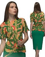 Блуза зелено-оранжевая из соединенных сеткой  плотных мотивов