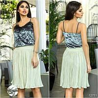 Стильная юбка на резинке, выполнена из оригинальной ткани с отделкой плиссе.