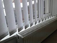 Білі вертикальні тканинні жалюзі