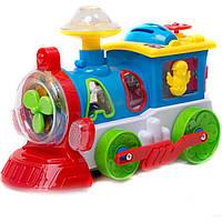 Музыкальная развивающая игрушка паровозик 8688J на батарейках, , сортер, логика, свет., 20*16,5*13 см