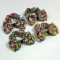 Резинка шифоновая бантик с цветочками. В упаковке 12шт. Цена 1шт - 14.60грн.