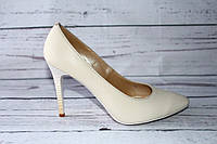 Женские кожаные туфли-лодочки бежевого цвета