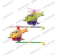 """Каталка 0302 """"Вертолет"""", на планке 53 см, звук, винт вращается, моргает глазками, показывает язык, в кульке"""