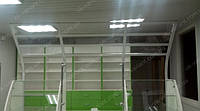 Мебель для аптеки с демонстрационным фризом для выкладки рекламируемого товара. Аптека также имеет пристенные стеллажи с выдвижными ящиками, кассы, прилавки и витрины стеклянные на замках.