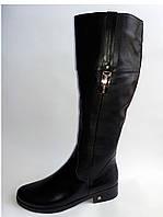 Женские  сапоги на низком каблуке кожаные