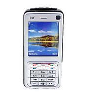 Шокер телефон Kelin K95: мощность электроразряда 25000 кВ, толщина пробоя 35 мм, встроенный фонарь