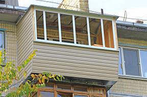 Преимущества наружной обшивки балкона сайдингом