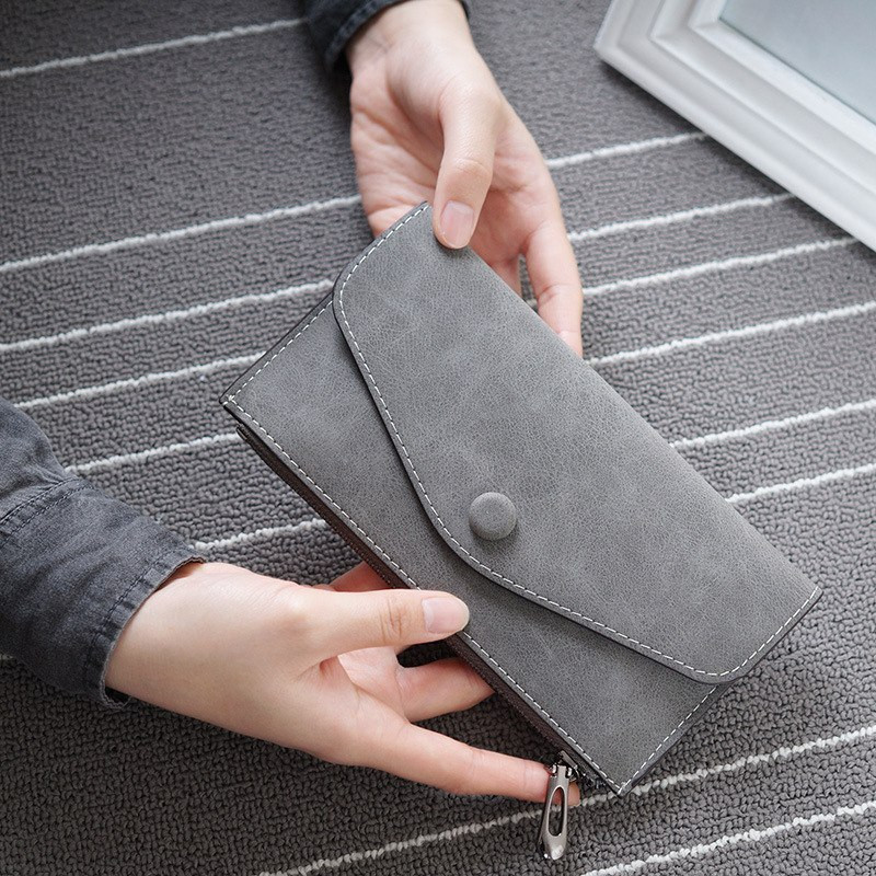 Женский кошелек серого цвета на молнии